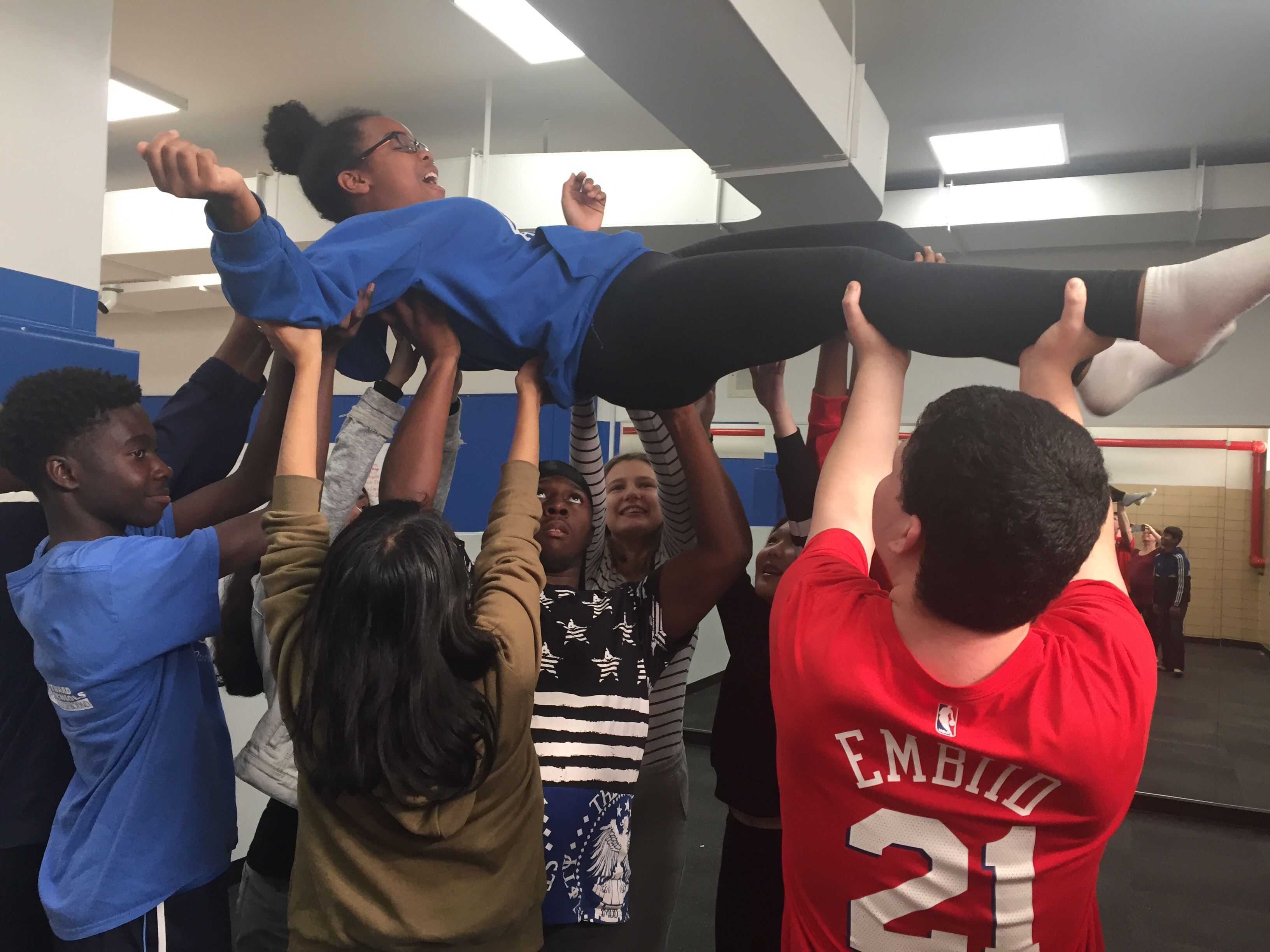 Students lifting up another student