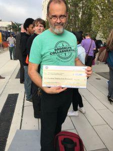 Eddie holding check
