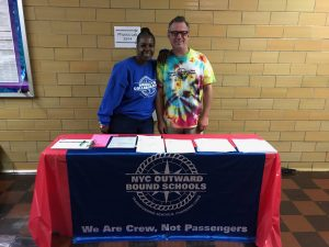 two staff members at HS Fair table