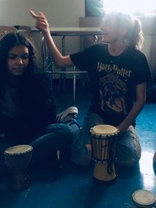 students playing small drum