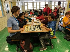 teacher and student playing chess