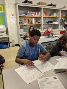 student reading essay