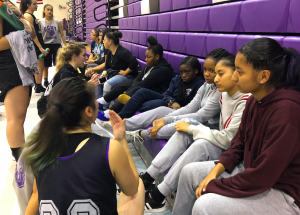 girls basketball team speaking to college athletes