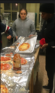 students cooking pizza